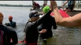 Woman swims for breast cancer awareness