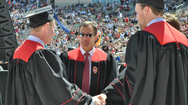 UW hockey coach graduates day after his daughter