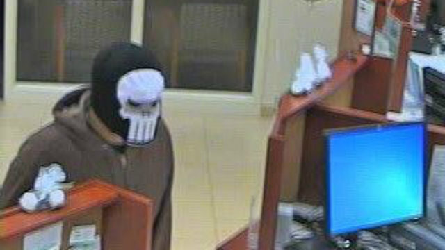 Police search for armed bank robber
