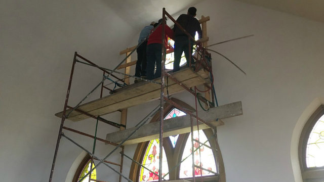 Janesville students watch installation of stained glass window they helped make