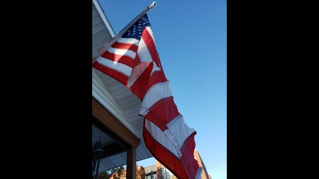 Woman says someone destroyed her American, Trump flag; spray-painted home on Veterans Day