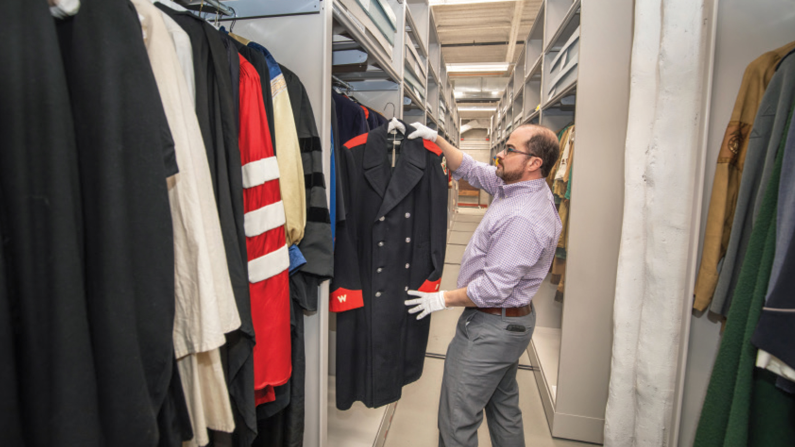 Joe Kapler, lead curator for the Wisconsin Historical Society's Museums and Historic Sites, looks through the apparel collection