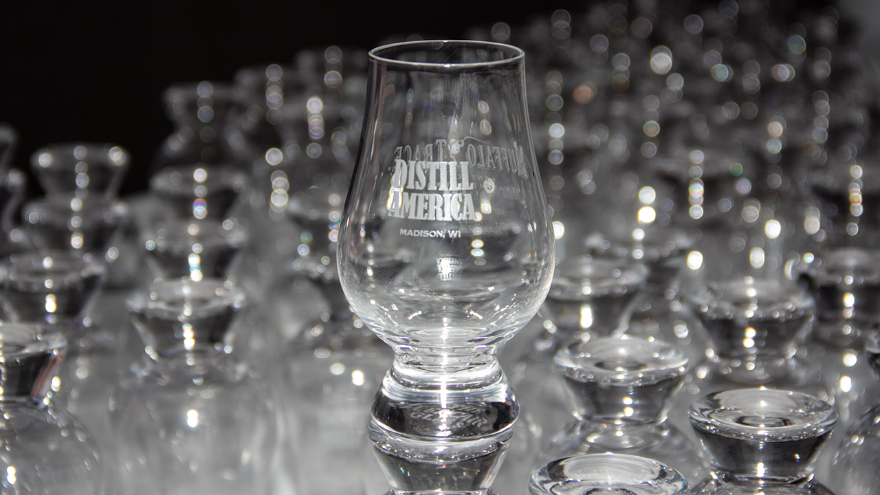 Tasting glass with Distill America label on the front.