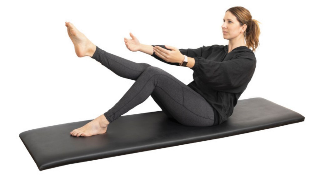 person stretching to one foot