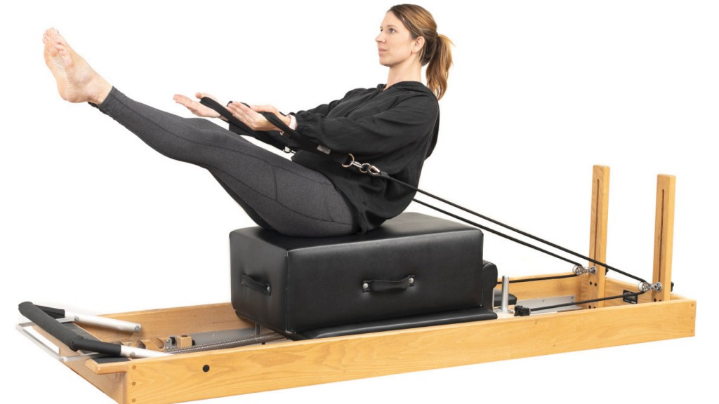 person on a reformer machine