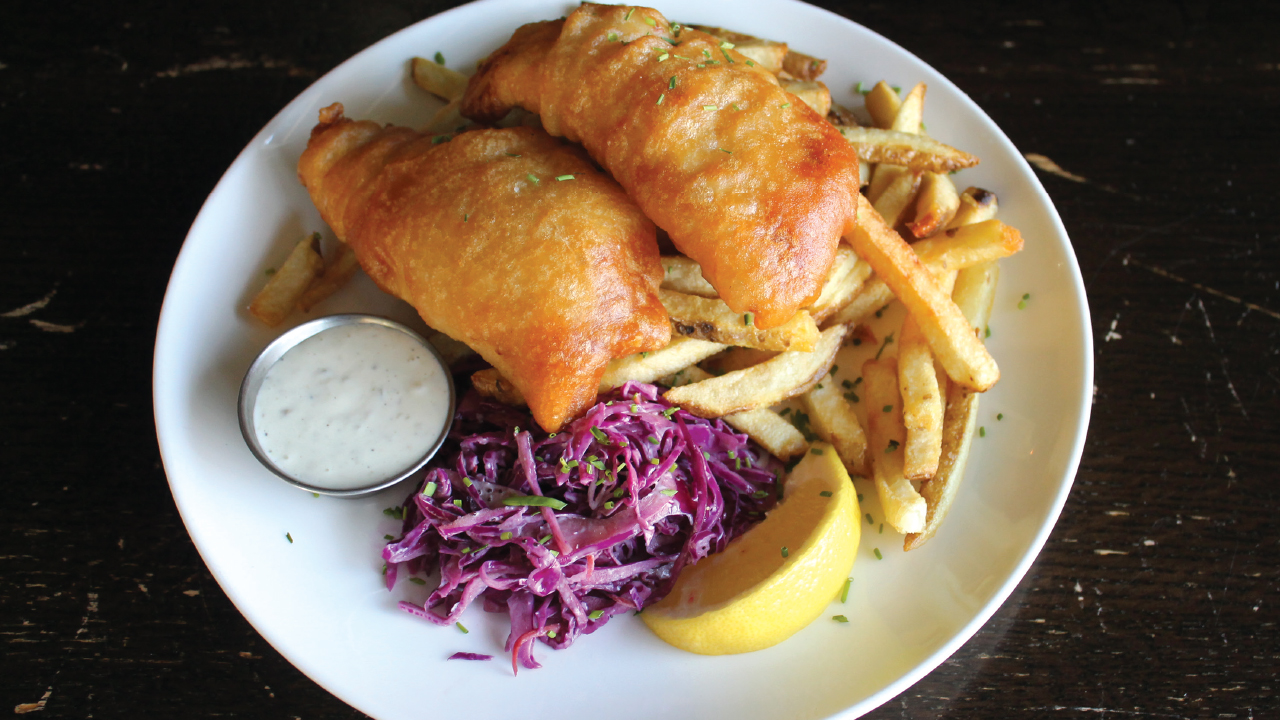 plate of fish fry from merchant with fries and coleslaw