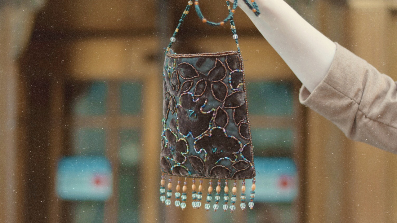 Close up of a beaded fringed 1920s purse
