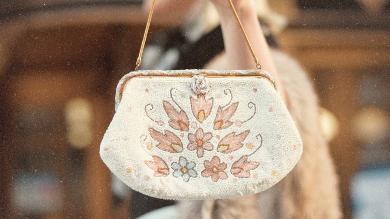 Close up of an embroidered white purse