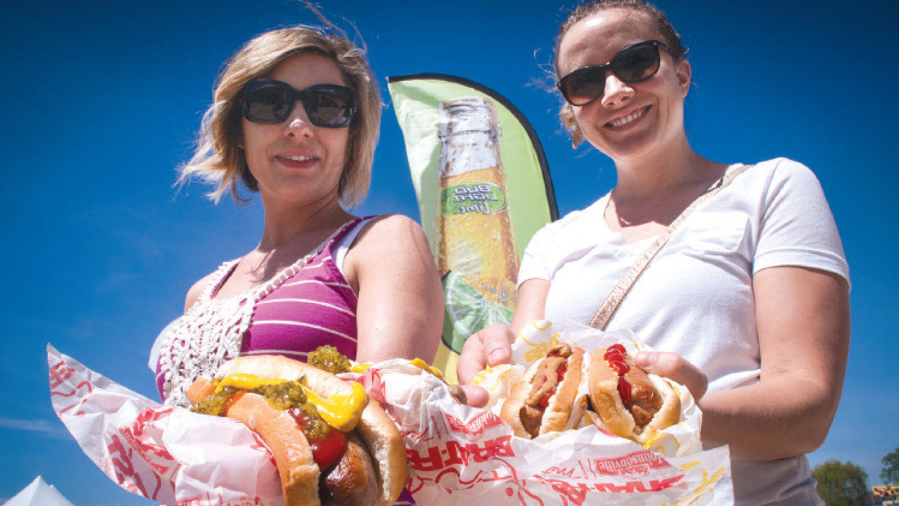 two people enjoying their brats at Brat Fest