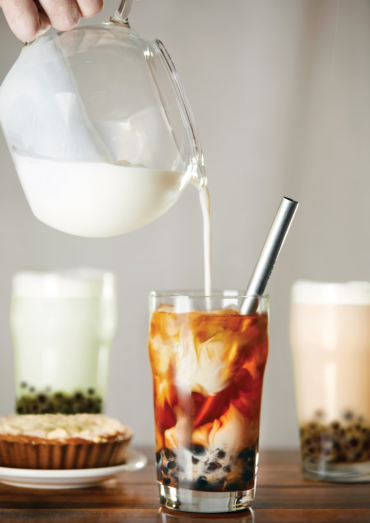 Milk being poured into bubble tea