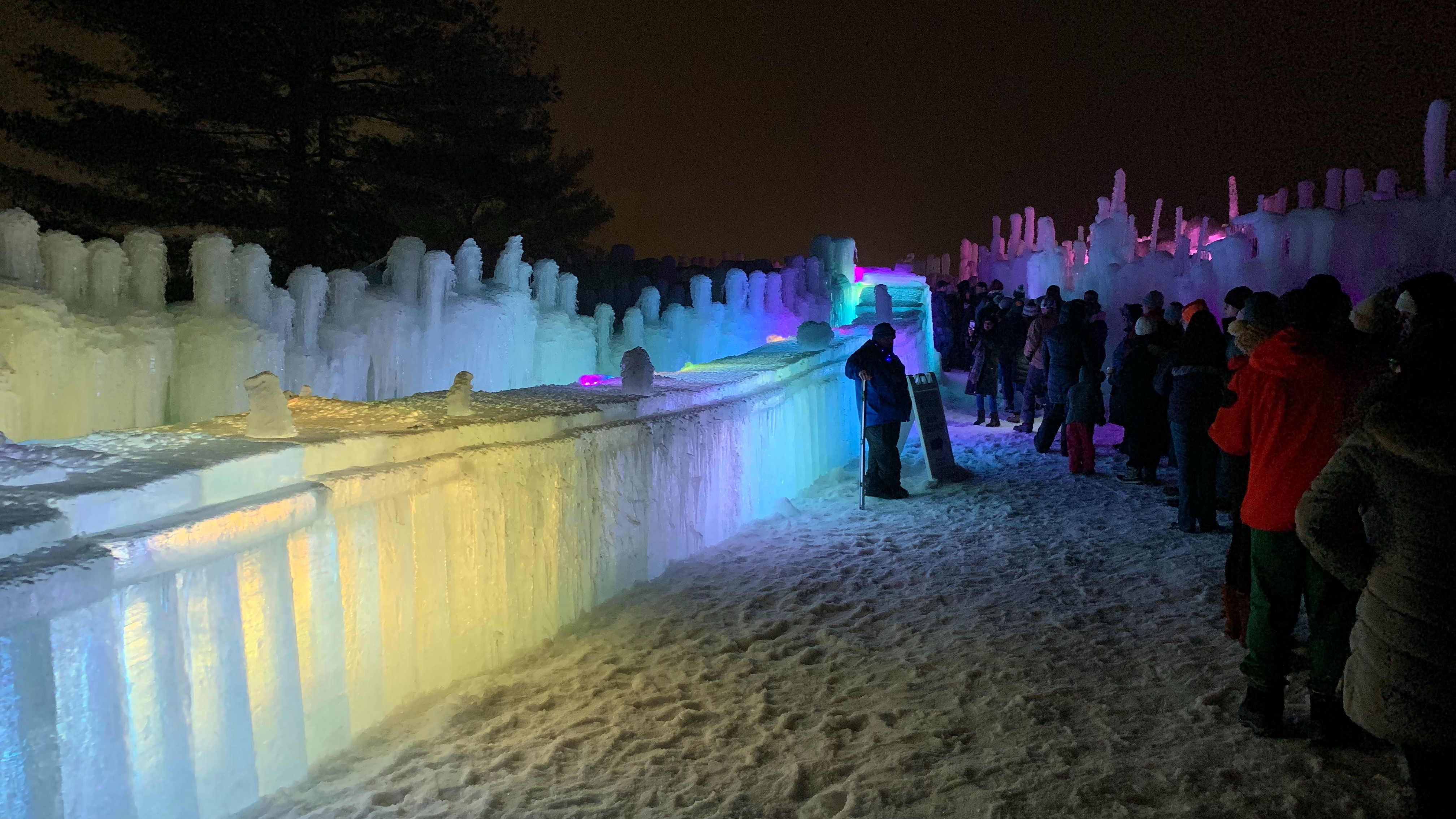 people walking around the ice castles