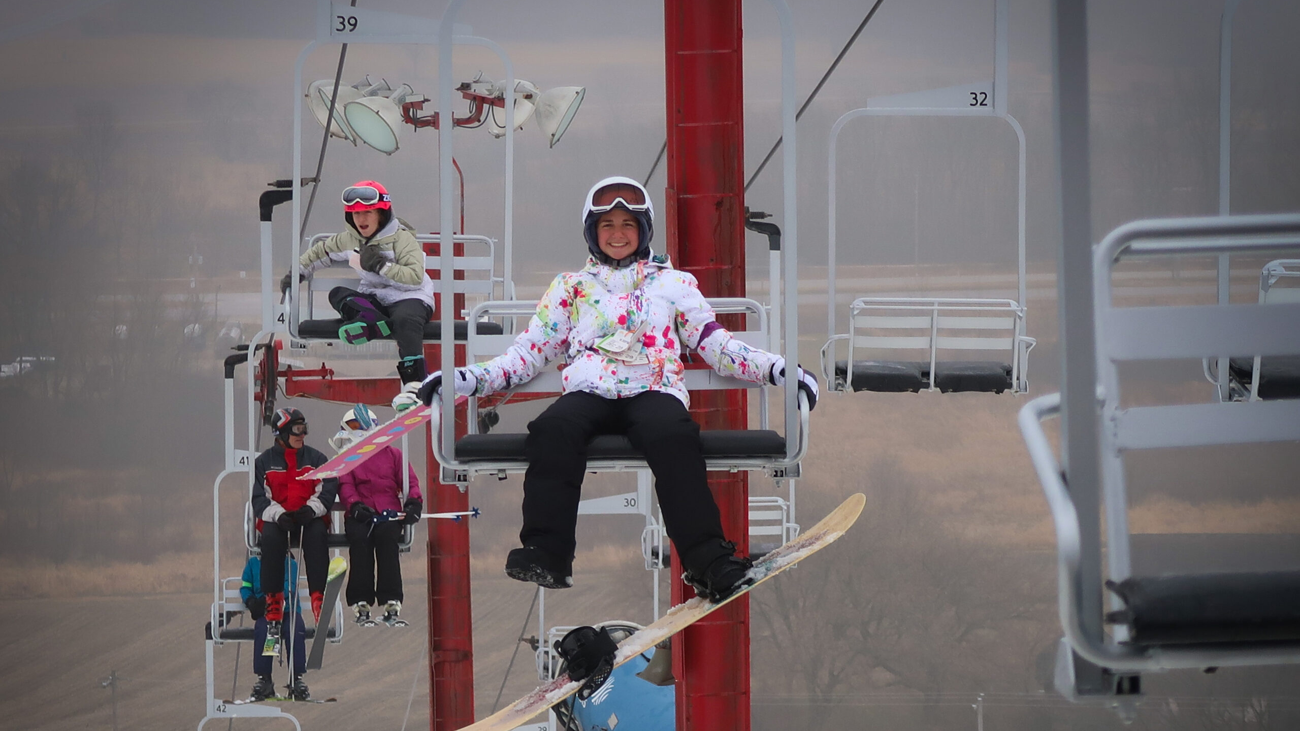 individuals riding a ski lift