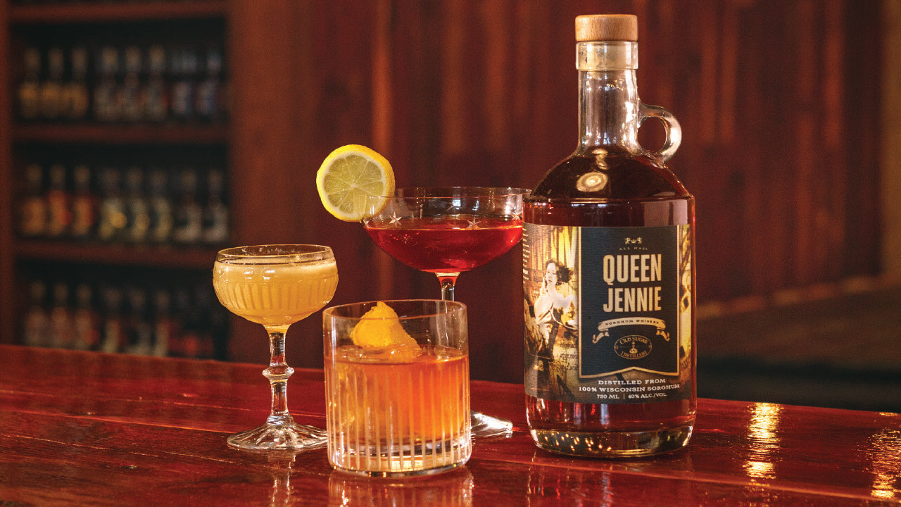 bottle of Queen Jennie along with three cocktails