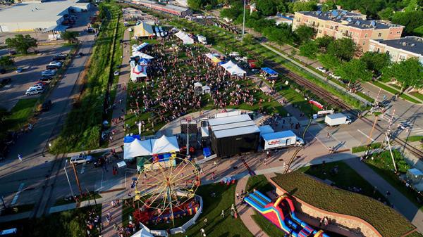 a drone photo overlooking fete de marquette's crowd of people and tents