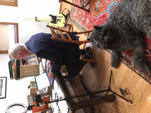 Neil Heinen in his home office with his dog Macaroon