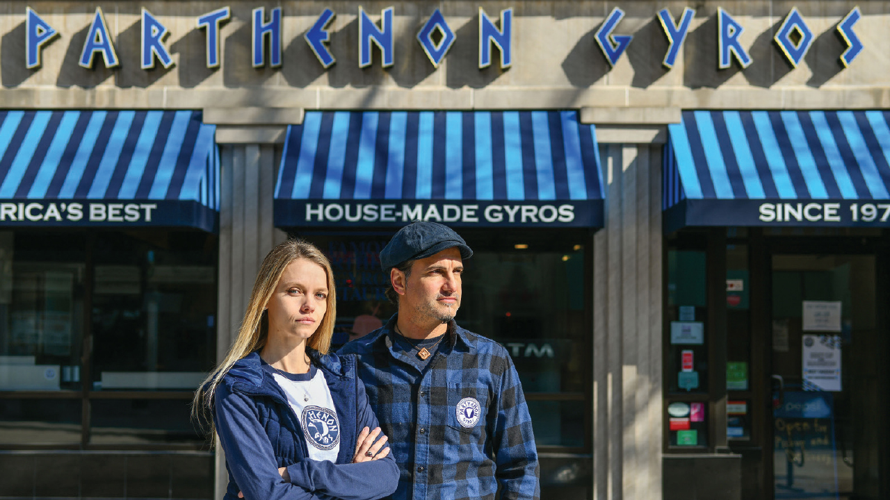 Erin and Dimitri Vranas standing in front of Parthenon Gyros