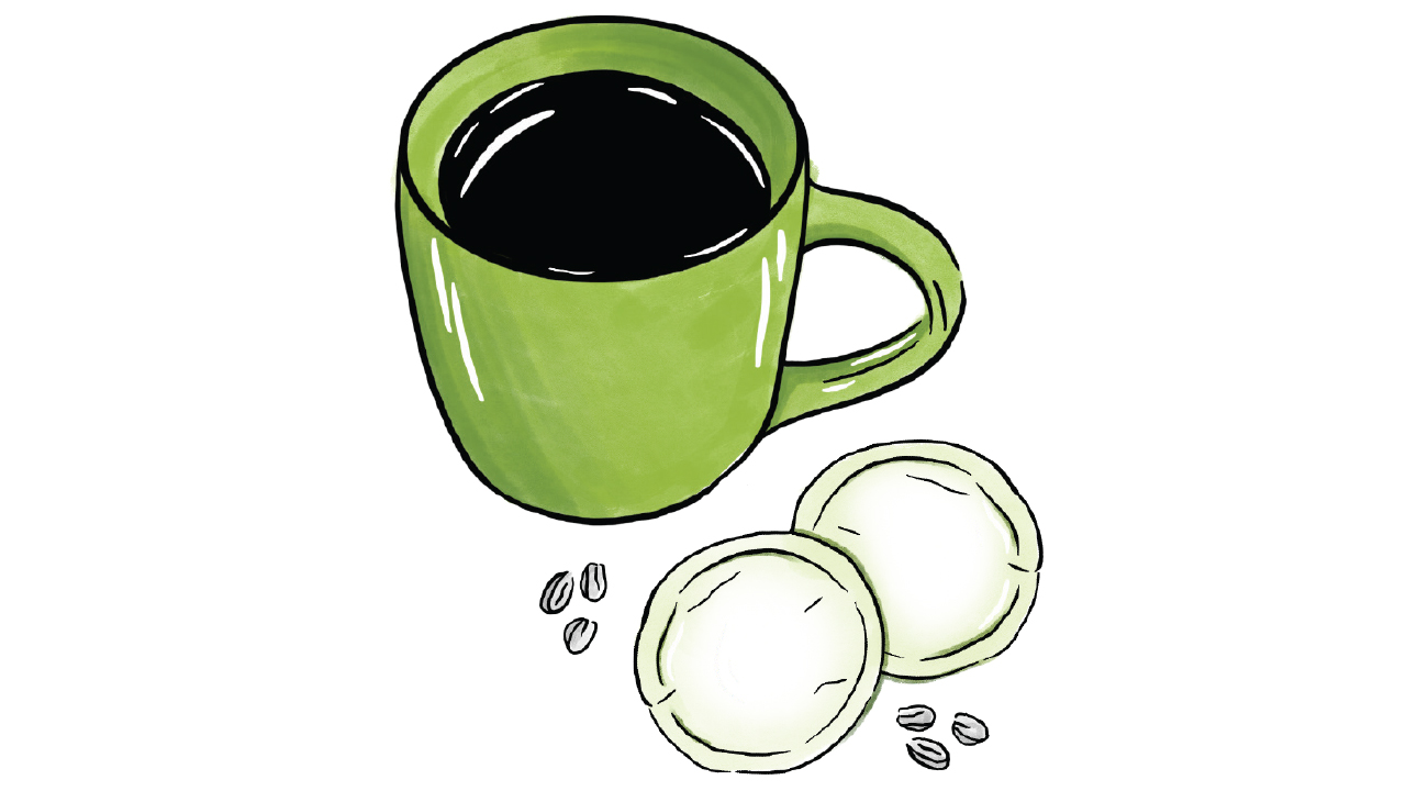two coffee pods with a coffee cup