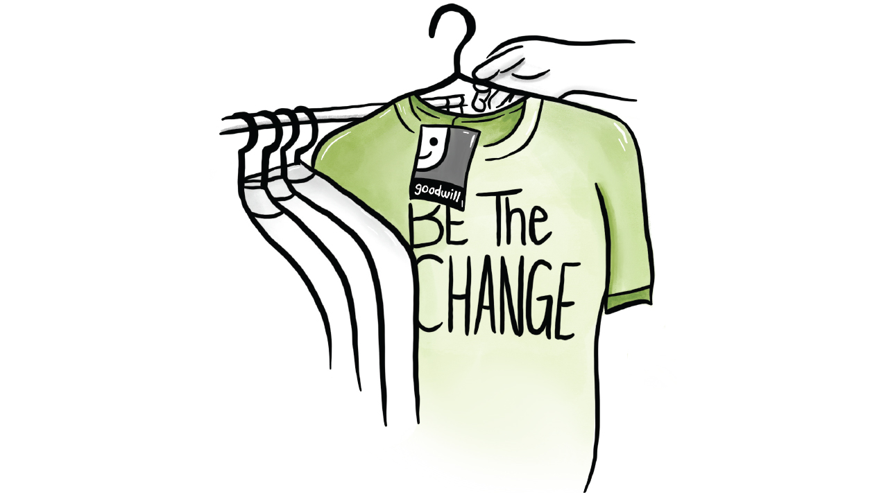 """putting a shirt that says """"Be the Change"""" with a goodwill tag"""
