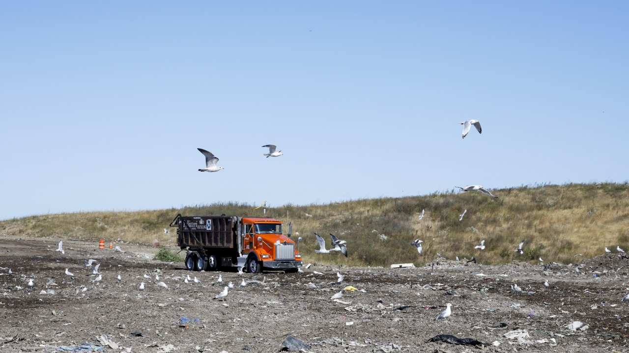 truck driving through the landfill
