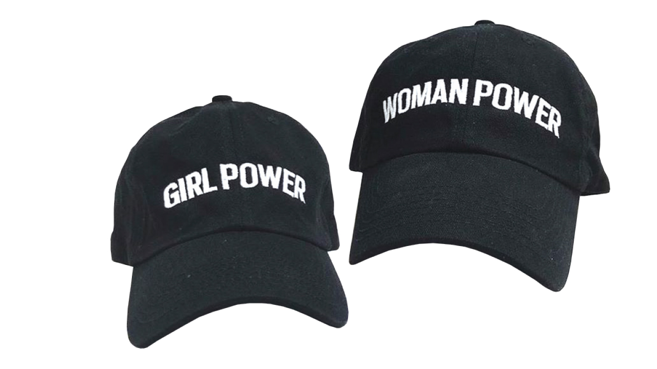 two hats one saying woman power, another girl power