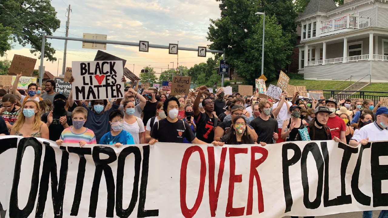 Crowd holds community control over police sign
