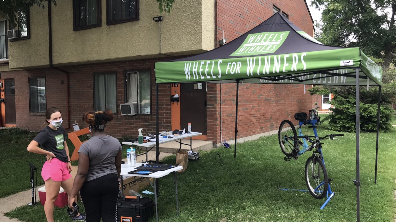 A tent and bike at a delivery event at the Bayview Foundation.