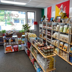 Shelves are full of pasta, olive oil and other goods inside Cibus Italian Market, a new market in Waunakee WI.