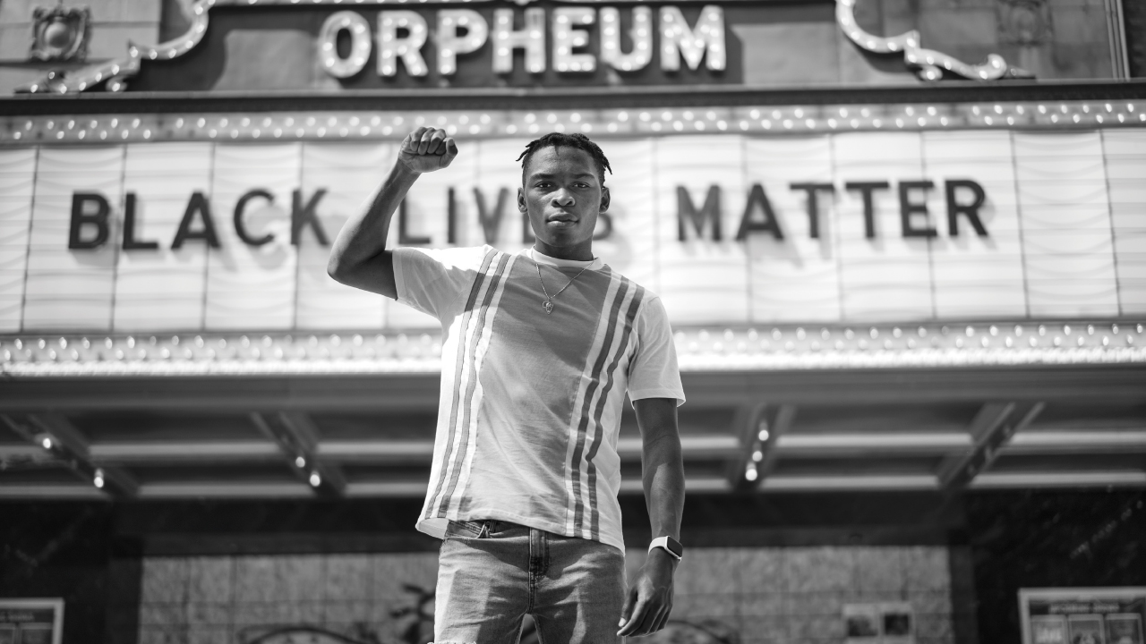 Noah Anderson standing in front of the Orpheum Theater