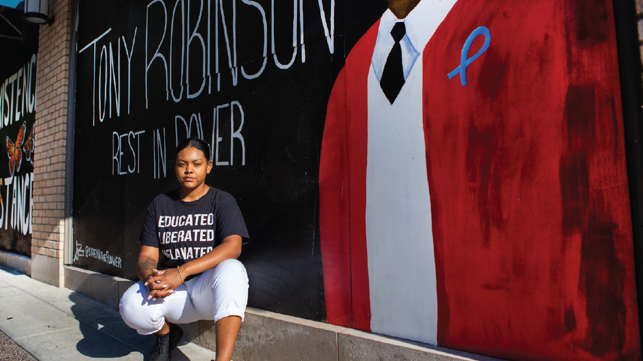 Sirena Flores in front of Tony Robinson Mural