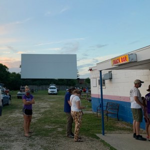 People stand in line at snack bar at the Highway 18 drive-in.