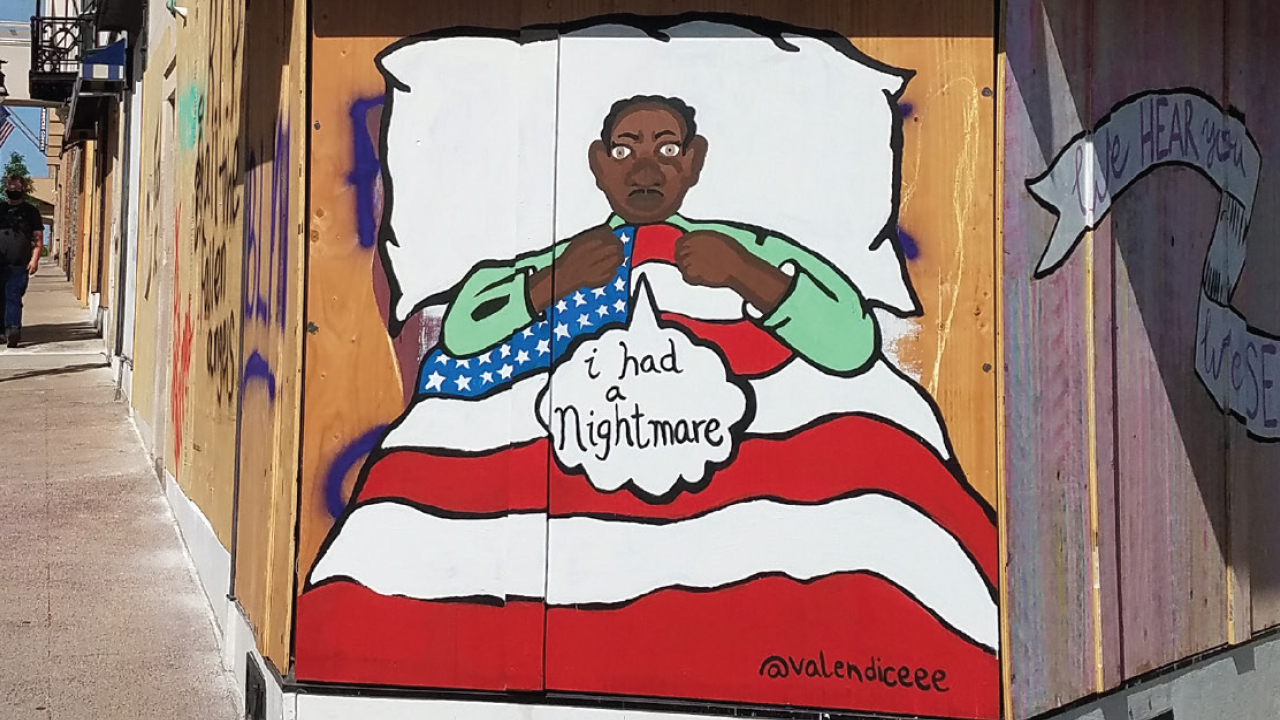 "mural of a Black person sitting in bed with an American flag and the person says ""I had a nightmare"""