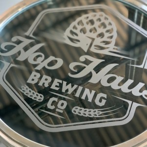Hop Haus' logo on top of a silver canister.