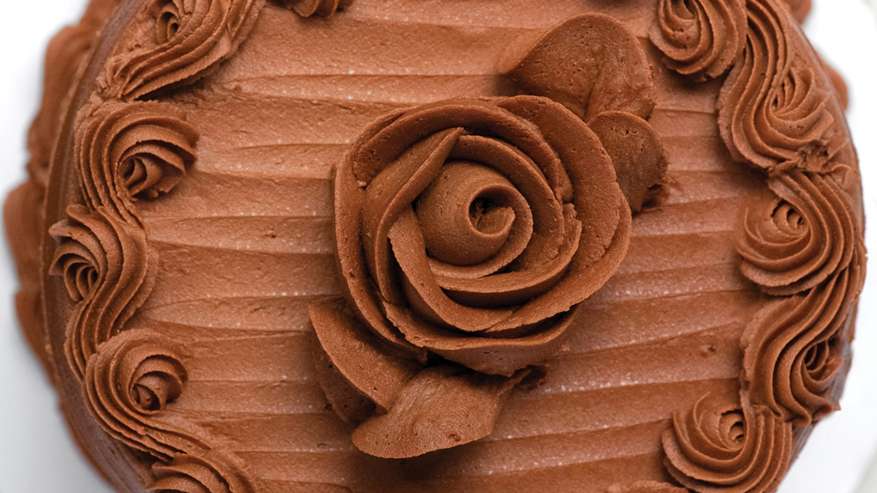 chocolate rose on top of a cake