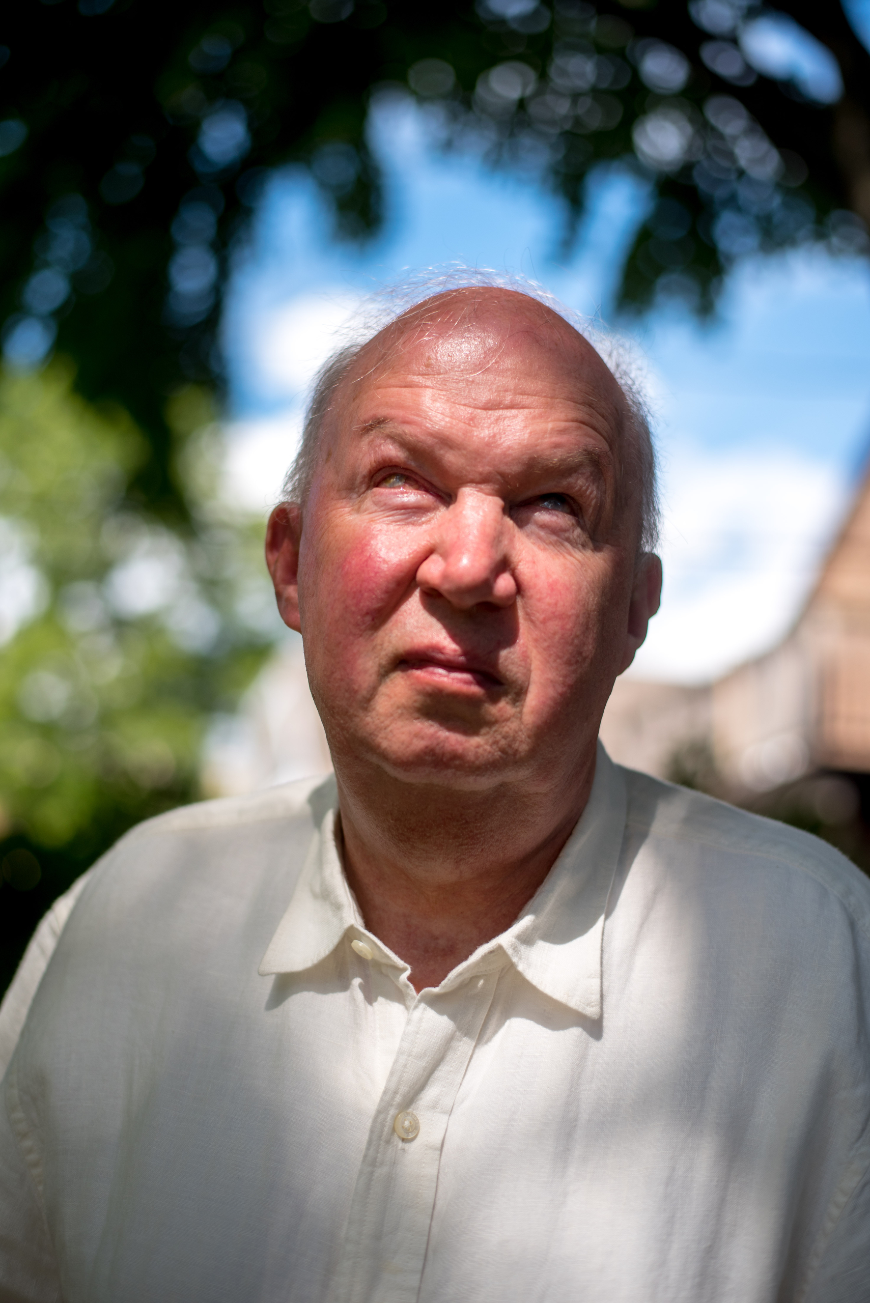 Don Natzke is seen in the backyard of his Shorewood, Wis., home on July 31, 2020. Natzke, who is blind, was unable to vote in Wisconsin's April 7 election as the COVID-19 pandemic kept him from his in-person polling place and he was unable to fill out an absentee ballot. Advocates fear that restrictive voting rules and the pandemic will keep some voters away from the polls on Nov. 3.