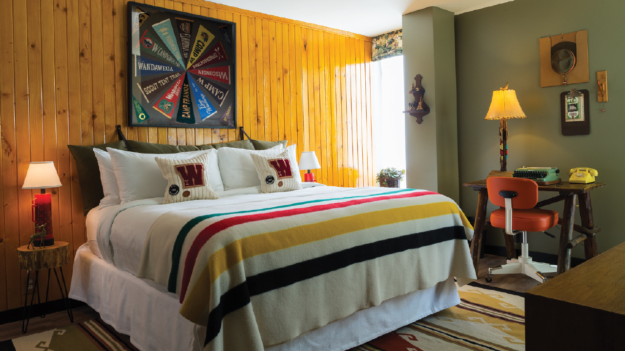 bedroom at The Graduate Hotel with a colorful bedspread