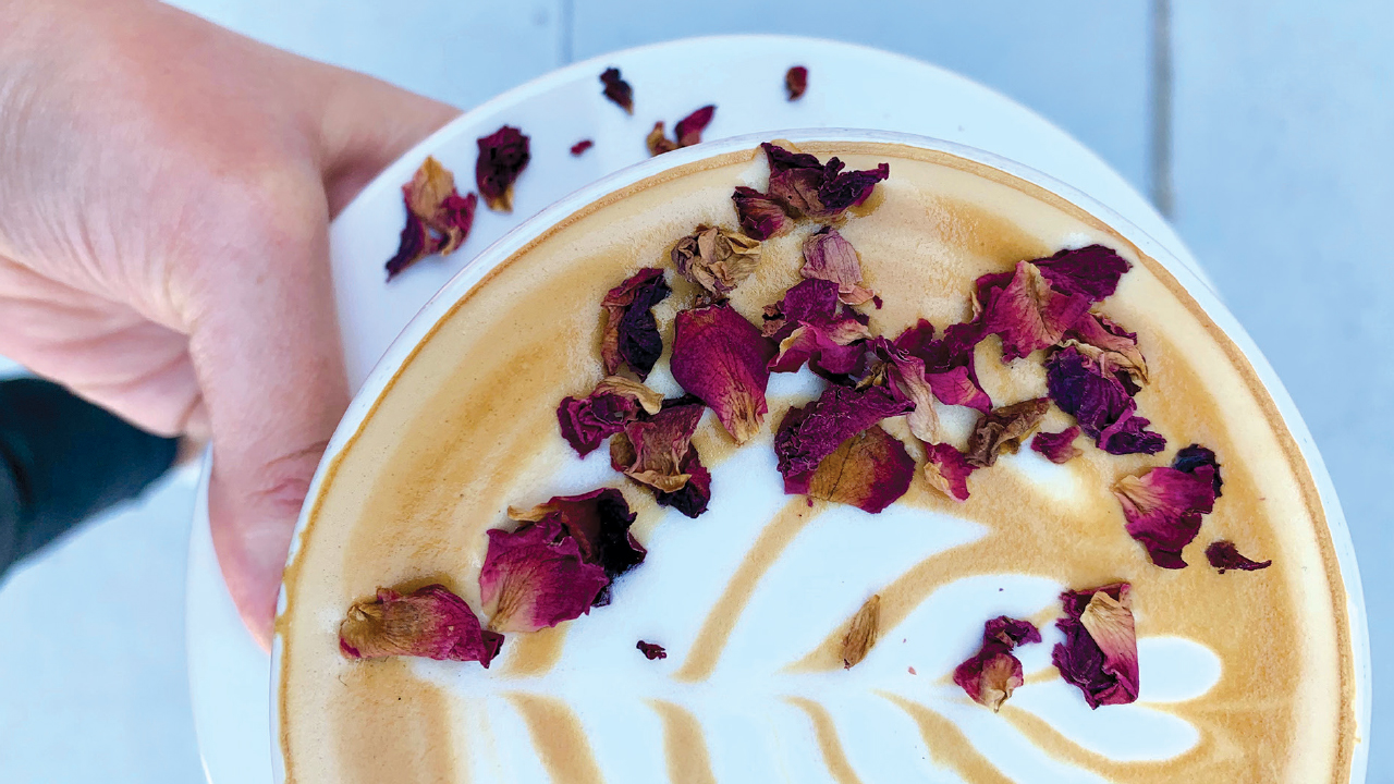 latte with flower petals on top