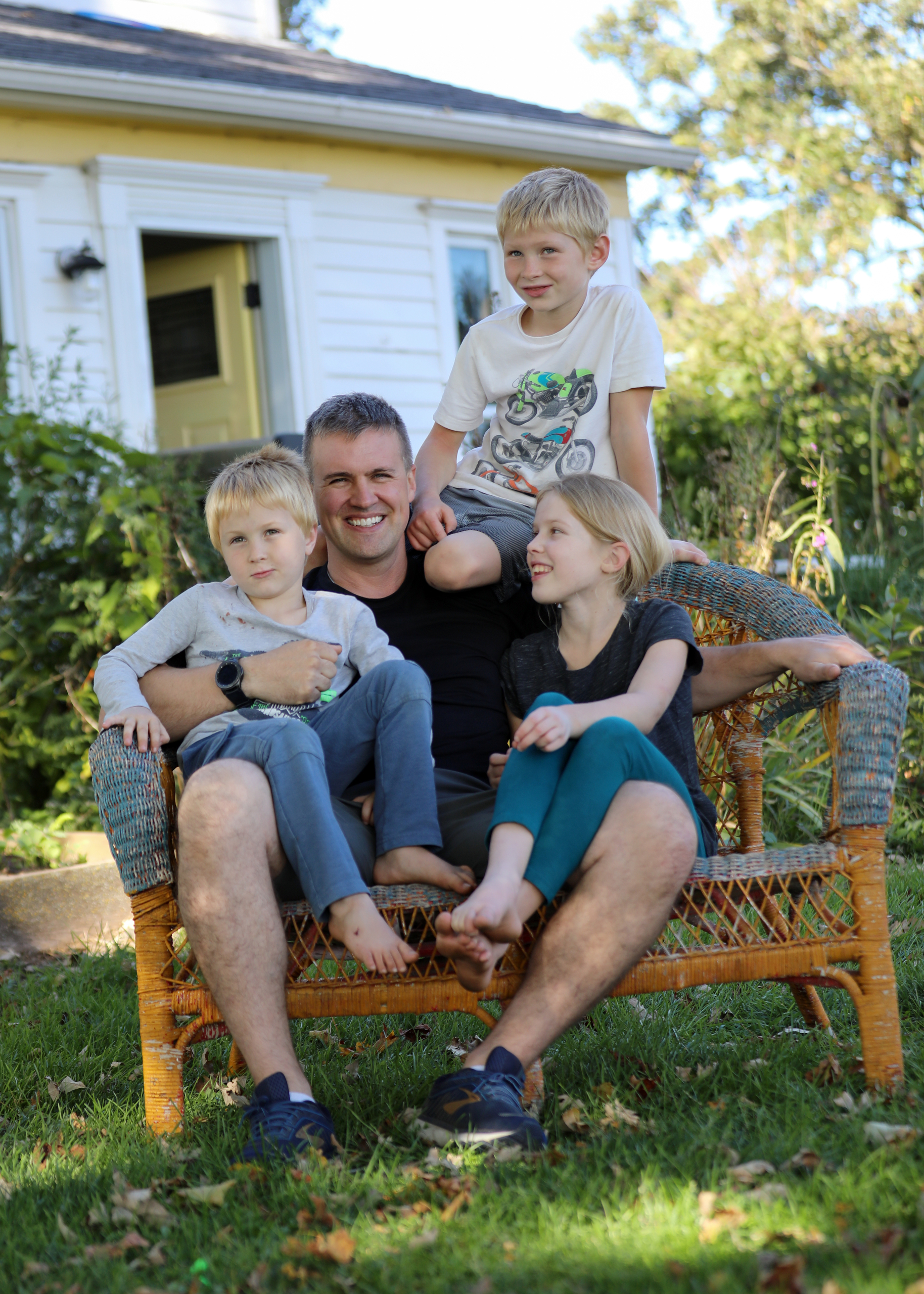 Matt Millar is seen with his children, from left, Matthias, 5, Adara, 10, and Sterling, 7, outside his house in Blue Mounds, Wis., on Sept. 18, 2020. Matt Millar says he prefers a combination of in-person and online learning for his children. But for now, they must learn from home after the Barneveld School District closed its building because of a case of COVID-19.