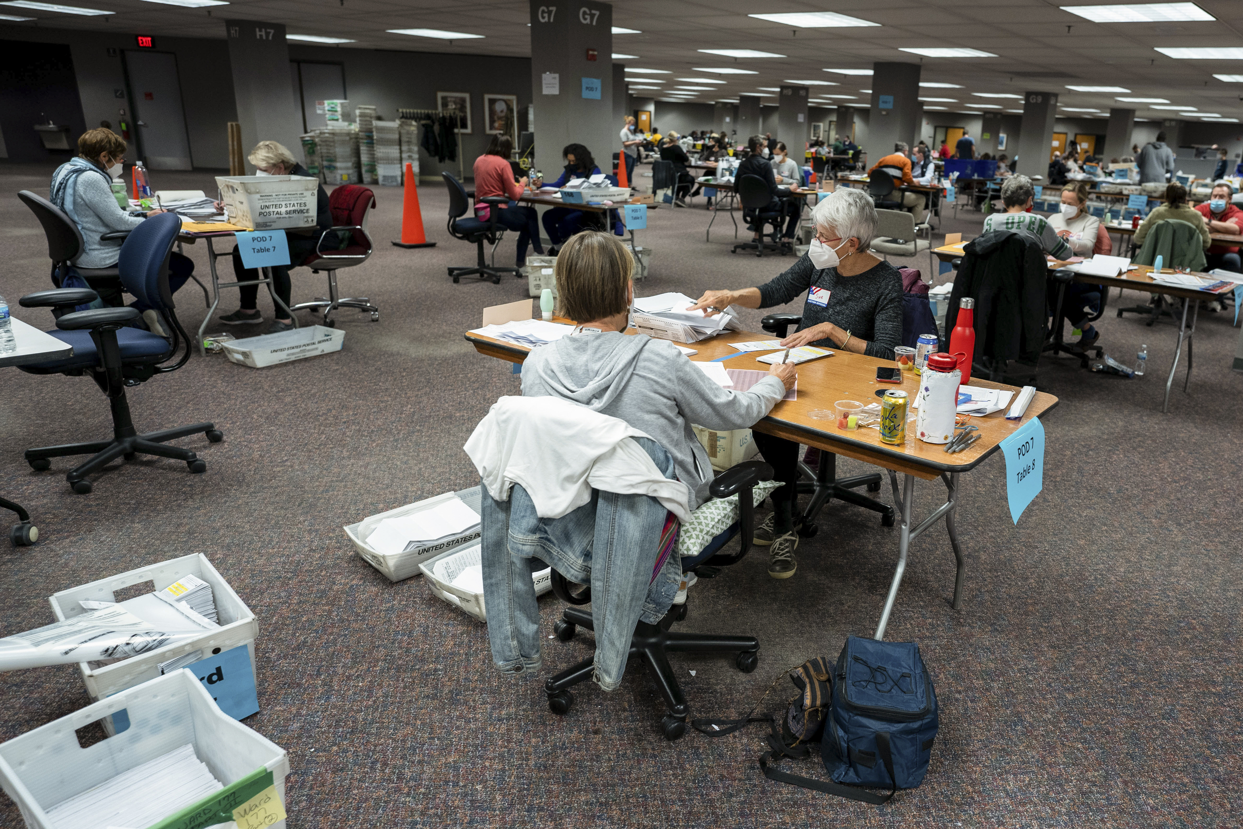 Election workers count ballots at the Milwaukee Central Count location after the polls had closed for the evening, on Nov. 3, 2020. Workers processed 169,000 absentee ballots at Central Count from 7 a.m. on Nov. 3 to 4 a.m. on Nov. 4, when results were released.
