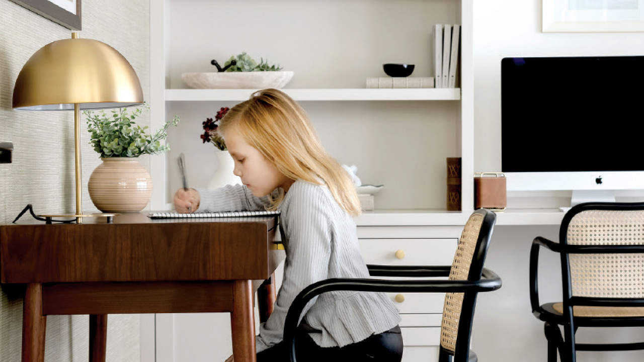 little girl working at a desk