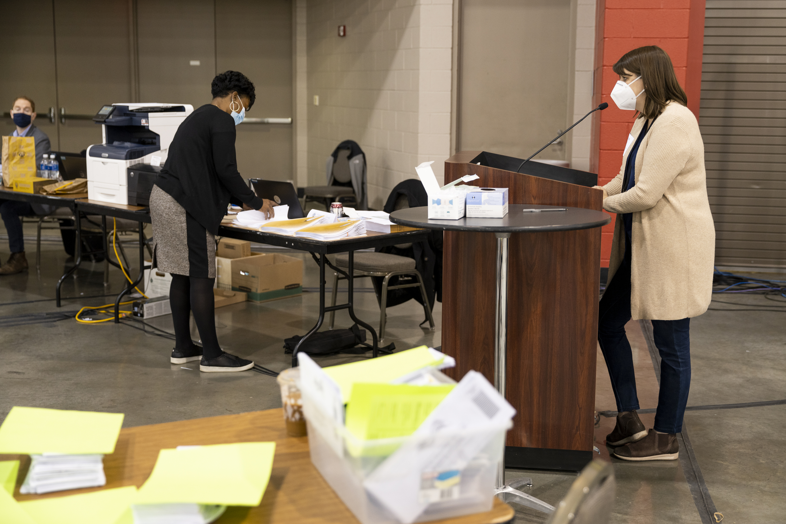Claire Woodall Vogg, Executive Director Of Milwaukee's Election Commission, Speaks With Republican Commissioner Rick Baas (middle) And Milwaukee County Clerk George Christenson (right) During The Presidental Recount Held At The Wisconsin Center Convention Center In Milwaukee, Wi On Wednesday November 25th, 2020.
