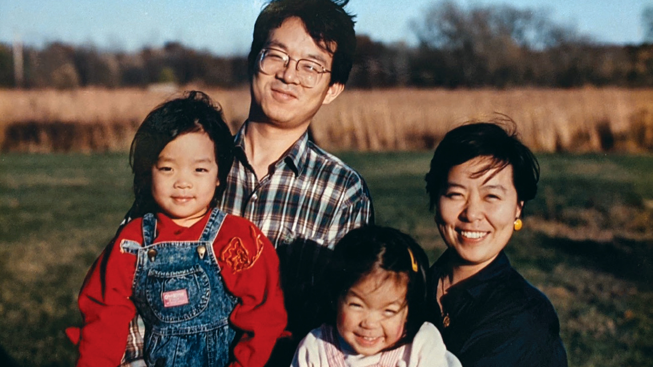 Francesca Hong as a child with her parents and sister