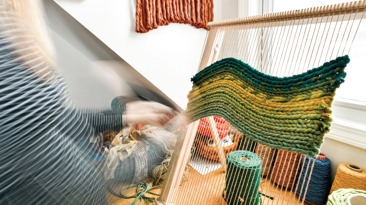 Courtney working on the loom