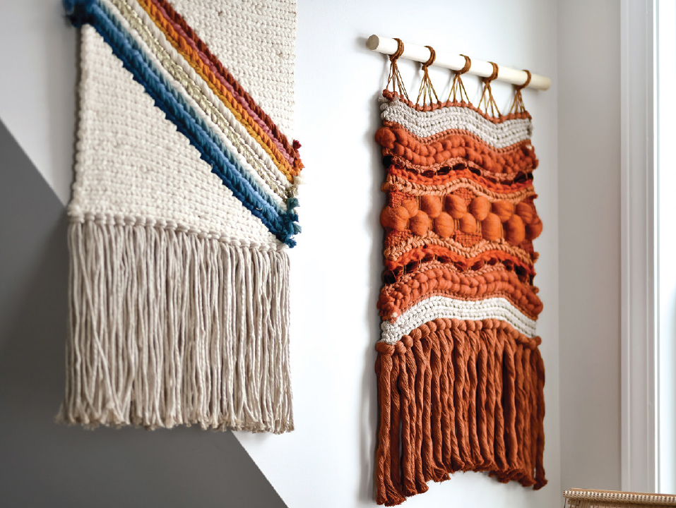two wall hangings one that's orange and one with white an rainbow
