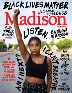 Ayomi Obuseh stands with her fist in the air on the August cover of Madison Magazine