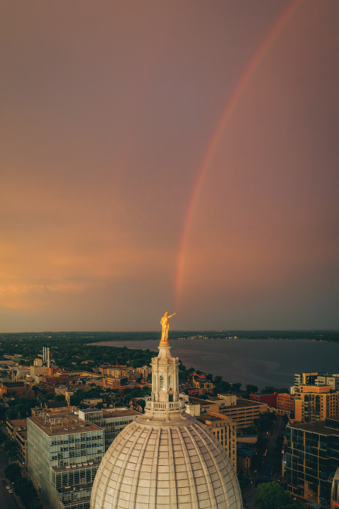 rainbow extending from the top of the capitol
