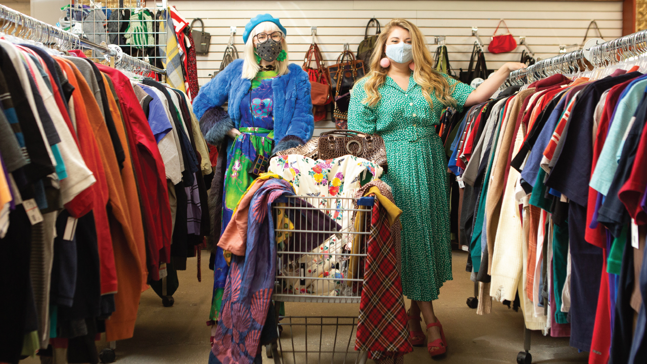 saraid and allie standing in between rows of clothing