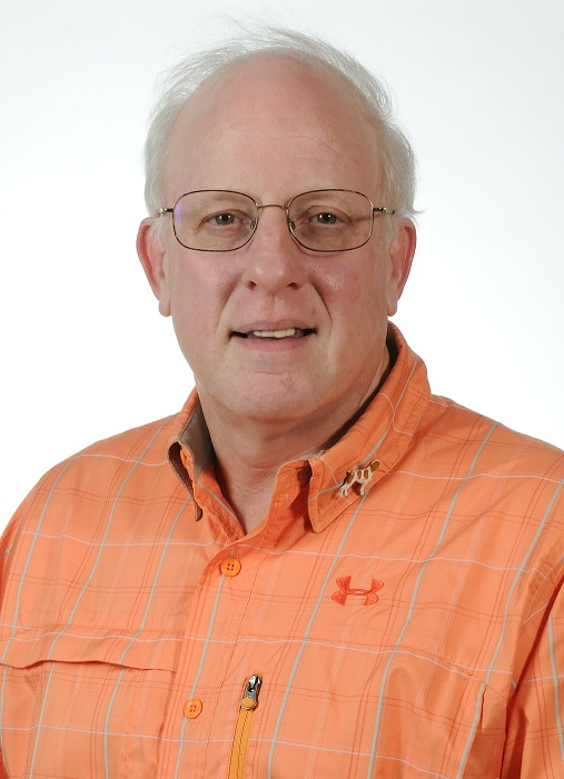 Portrait in orange shirt with glasses and silver hair, Robert Ross of Forest Products Laboratory.