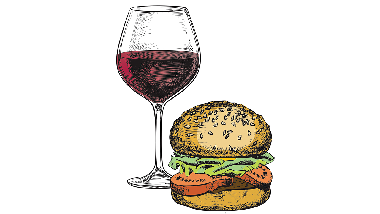 Burger with a glass of red wine