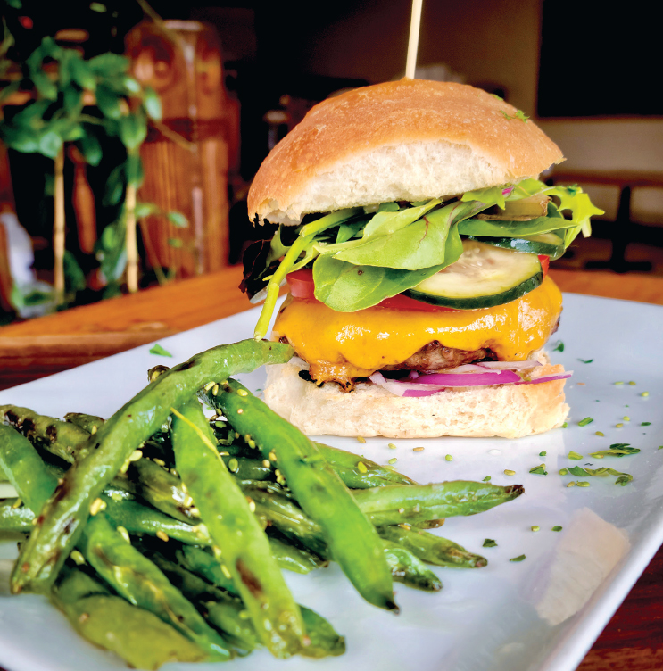 burger with side of charred green beans