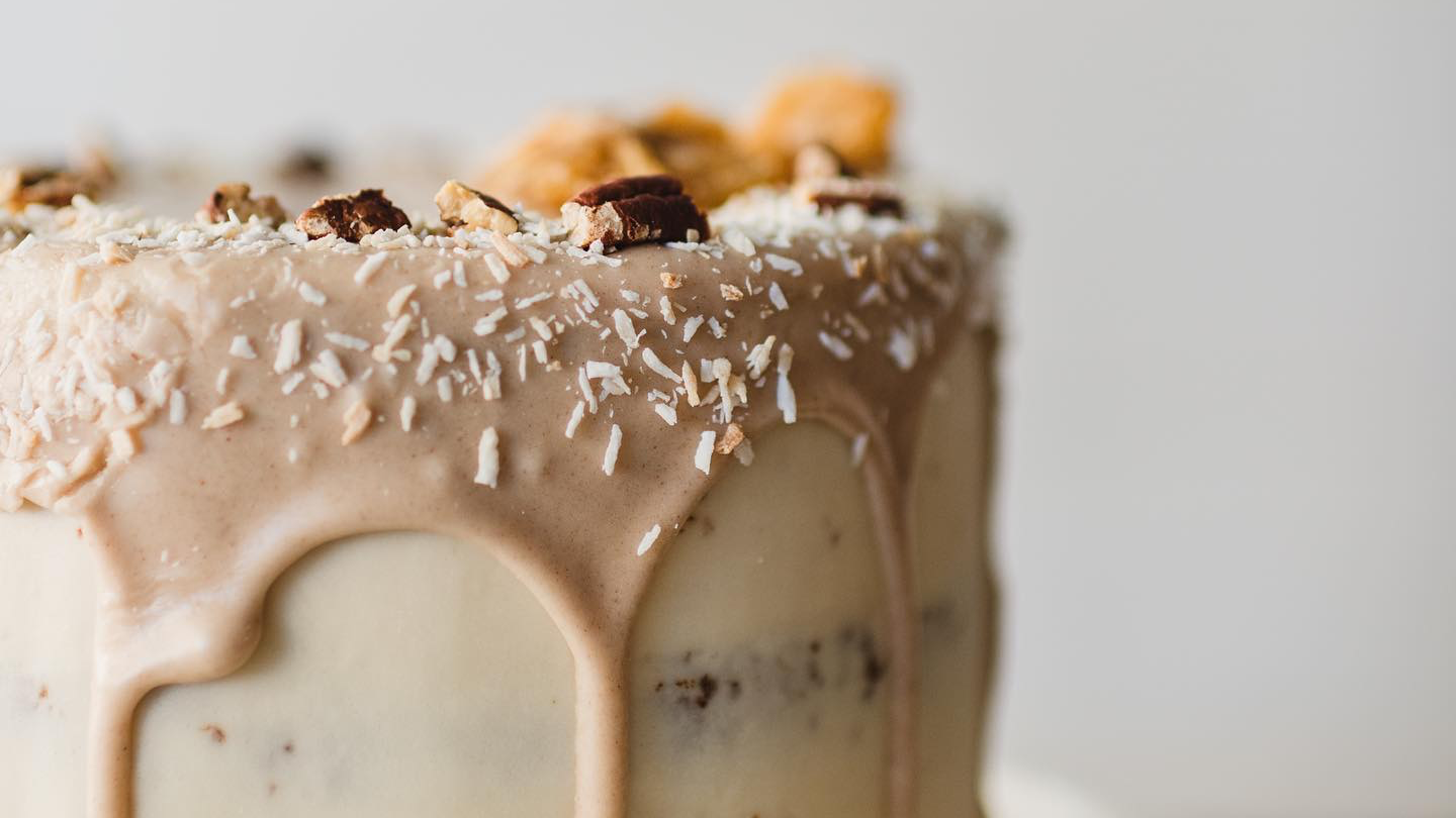 Close-up shot of a frosted hummingbird cake